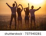 the four people jumping on the... | Shutterstock . vector #737540281
