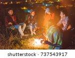 the five friends warming hands... | Shutterstock . vector #737543917