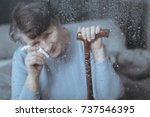 photo through window of lonely...   Shutterstock . vector #737546395