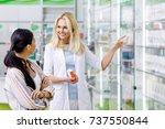 smiling pharmacist holding...   Shutterstock . vector #737550844