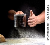 Small photo of hand sift the flour on black background
