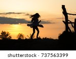 girl silhouette dancing at... | Shutterstock . vector #737563399