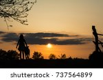 silhouettes of a girl and her... | Shutterstock . vector #737564899