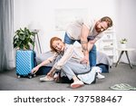 young couple packing clothes... | Shutterstock . vector #737588467
