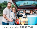 beautiful young family packing...   Shutterstock . vector #737592544