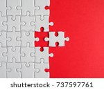 one white jigsaw puzzle beside... | Shutterstock . vector #737597761