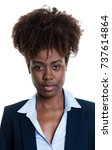 Stock photo passport photo of a serious african american businesswoman 737614864