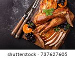 carved turkey on a cutting... | Shutterstock . vector #737627605