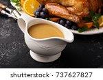 homemade gravy in a sauce dish... | Shutterstock . vector #737627827