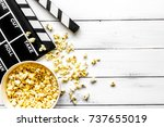 watching movie with popcorn on... | Shutterstock . vector #737655019