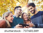 group of young people in park... | Shutterstock . vector #737681389