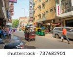 Small photo of DELHI, INDIA - SEPTEMBER 19, 2017: Busy Indian Street Market in New Delhi, India. Delhi's population surpassed 18 million people