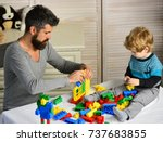 dad and kid build house of... | Shutterstock . vector #737683855