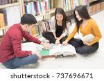 Group Of Three Student Do...