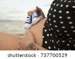 pregnant woman with a pair of... | Shutterstock . vector #737700529