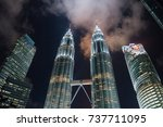 Small photo of KUALA LUMPUR, MALAYSIA - OCTOBER 9: Night view of The Petronas Twin Towers on August 28, 2011 in Kuala Lumpur, Malaysia. The skyscraper (451.9m/88 floors) is the tallest twin buildings in the world