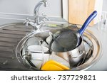 a lot of dirty dishes in... | Shutterstock . vector #737729821
