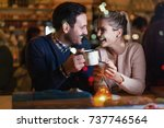 happy couple talking at bar and ... | Shutterstock . vector #737746564