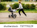 young mother jogging with a... | Shutterstock . vector #737770129