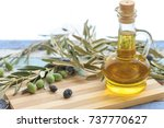 olive oil in glass  with olives ... | Shutterstock . vector #737770627