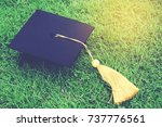 shot of graduation hats on the... | Shutterstock . vector #737776561
