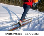 Female Skier Casts A Long...