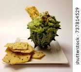 Small photo of African Horned Cucumber filled with Guacamole served with multigrain chips