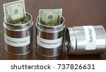 money in cans for budgeting... | Shutterstock . vector #737826631
