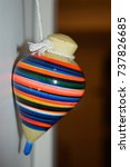 Small photo of front view look of a children adult vintage old antic toy handmade colorful with white door shadows hanging on a rope