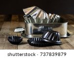 old baking molds on an old... | Shutterstock . vector #737839879
