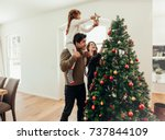 Family Decorating A Christmas Tree - Fine Art prints