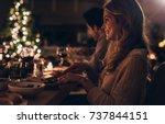 beautiful young woman sitting... | Shutterstock . vector #737844151