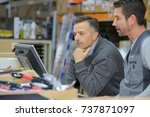 boss and worker checking... | Shutterstock . vector #737871097