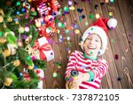 happy child holding party... | Shutterstock . vector #737872105