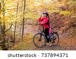 beautiful girl riding a bicycle ... | Shutterstock . vector #737894371
