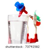 Red Toy In Blue Hat Dips By Bi...