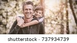 portrait of happy father... | Shutterstock . vector #737934739