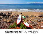 Surfing boards are resting on the tropical sand beach. Maui. Hawaii. - stock photo