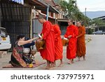 Small photo of Vang Vieng, Laos,- OCT 13 : 2017.Monk receive food offerings.