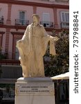 Small photo of CADIZ, ANDALUSIA, SPAIN - AUGUST 4, 2017: Statue of Lucius Junius Moderatus Columella, most important Roman agriculture writer, holding a sickle and ox-yoke at Plaza Topete (Plaza des Flores) square.