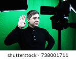 television presenter in a green ... | Shutterstock . vector #738001711