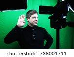 television presenter in a green ... | Shutterstock . vector #738001711