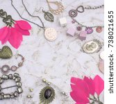 Small photo of Set vintage jewelry for women. Decorative composition frame, necklace, bracelet, locket, necklaces, earrings with feathers. Top view flat lay