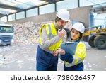 worker using walkie talkie in... | Shutterstock . vector #738026497