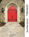 A Bright Red Door Of A Stone...