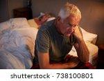 worried senior man in bed at... | Shutterstock . vector #738100801