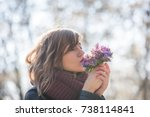 cute young girl smelling nice... | Shutterstock . vector #738114841