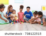 young volunteers playing with... | Shutterstock . vector #738122515
