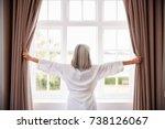 senior woman opening bedroom...   Shutterstock . vector #738126067