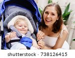 mother walking with a baby pram ...   Shutterstock . vector #738126415